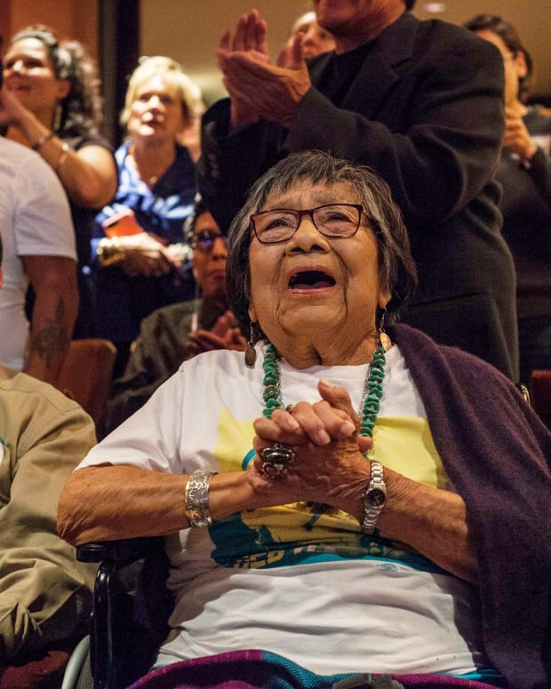 """In this Nov. 6, 2018, file photo, Mary Toya, mother to then congresswoman-elect Deb Haaland, celebrates Haaland's win in Albuquerque, N.M. midterms election night. The mother of now U.S. Interior Secretary Deb Haaland has died, authorities said Sunday, Oct. 17, 2021. Officials with the Department of the Interior didn't immediately release Mary Toya's age or a cause of death. In a statement, Haaland's spokeswoman Melissa Schwartz said """"we celebrate Mary Toya's long life and are grateful for her 25 years of service to Native students as a member of the Interior team within Indian Affairs. (AP Photo/Juan Labreche, File)"""