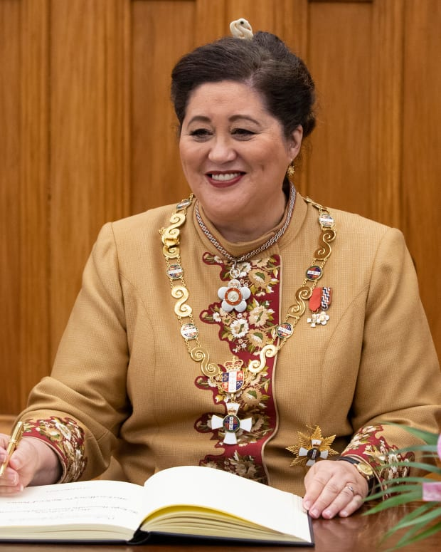 New Zealand Governor-General Dame Cindy Kiro signs a visitor's book after her official swearing-in ceremony at Parliament in Wellington, New Zealand, on Oct. 21, 2021. Kiro, 63, is the first female Maori governor-general. She said her mixed Maori and British heritage help give her a good understanding of New Zealand history and the Treaty of Waitangi, the founding document signed by Maori and British. (Mark Mitchell/New Zealand Herald via AP)