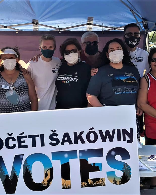 At a powwow on the Crow Creek Sioux Reservation, Native voting rights advocates promoted participation in redistricting. (Photo by Buffalo's Fire)