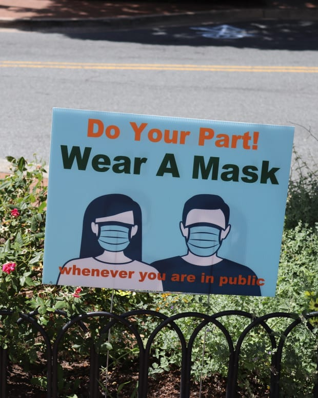 """""""Wear a mask"""" sign at Veterans Plaza at Fenton Street and Ellsworth Drive in Silver Spring, Maryland on Thursday afternoon, July 9, 2020. (Photo courtesy of Elvert Barnes Photography, Creative Commons)"""