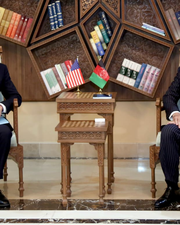 Abdullah Abdullah, Chairman of the High Council for National Reconciliation, right, meets with U.S. Secretary of State Antony Blinken, at the Sapidar Palace in Kabul, Afghanistan, Thursday, April 15, 2021. Blinken made an unannounced visit to Afghanistan on Thursday to sell Afghan leaders and a wary public on President Joe Biden's decision to withdraw all American troops from the country and end America's longest-running war. (Sapidar Palace via AP)