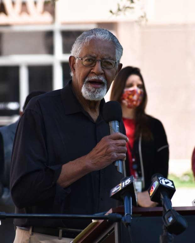 """Today we are back at the battleground,"" Mel Hannah of the Arizona NAACP tells the crowd of about two dozen on April 7, 2021. (Photo by Kelly Richmond/Cronkite News)"