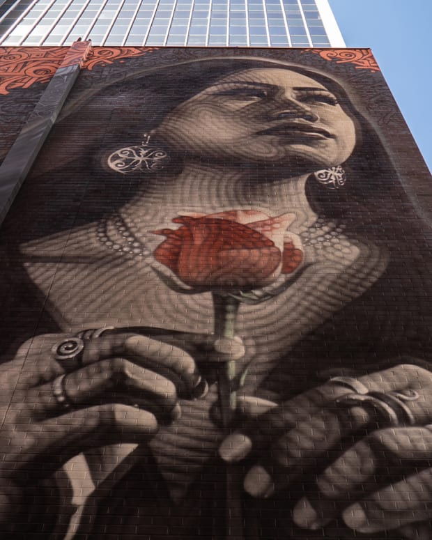 Four girls from the Salt River Pima-Maricopa Indian Community were photographed as possible subjects of the mural, which was finished in early April. (Photo by Sofia Fuentes/Cronkite News)