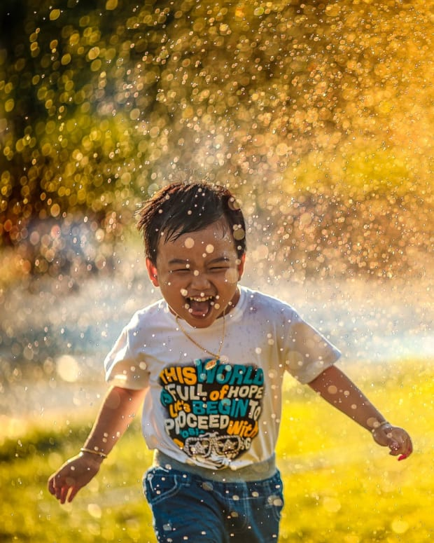 a happy child running through water