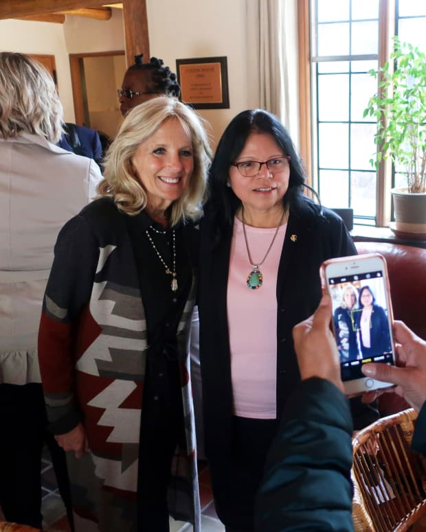 FILE - In this May 22, 2019, file photo, Jill Biden, left, and Tuba City Regional Health Care Corp. CEO Lynette Bonar pose for photos after an event in Flagstaff, Ariz. Biden is traveling to the country's largest Native American reservation, the Navajo Nation, which was hit hard by the coronavirus but is outpacing the U.S. in vaccination rates while maintaining strict pandemic restrictions. The trip, scheduled for Thursday and Friday, April 22-23, 2021, will be Biden's third to the reservation that spans 27,000 square miles (70,000 square kilometers) in the Four Corners region, and her inaugural visit as first lady. (AP Photo/Felicia Fonseca, File)