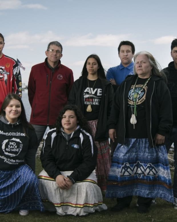 Pictured: Menominee youth gather at the mouth of the Menominee River with Tribal Chairman Douglas Cox and high school teacher Dawn Wilber.