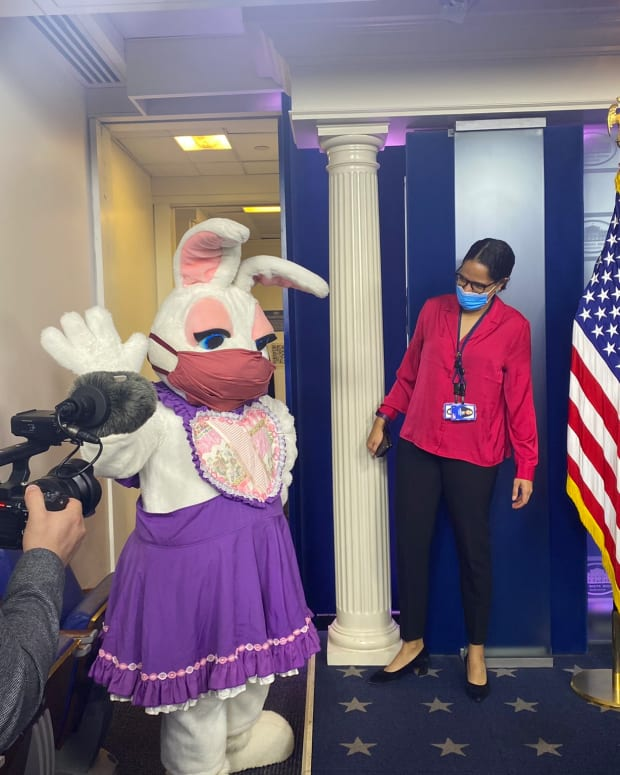 White House Press Office Chief of Staff Amanda Finney, Cherokee and Lumbee, witnessing the easter bunny's appearance in the White House briefing room on April 5, 2021. Finney also serves as a special assistant to the Press Secretary Jen Psaki. (Photo by Kelly O'Donnell via Twitter)