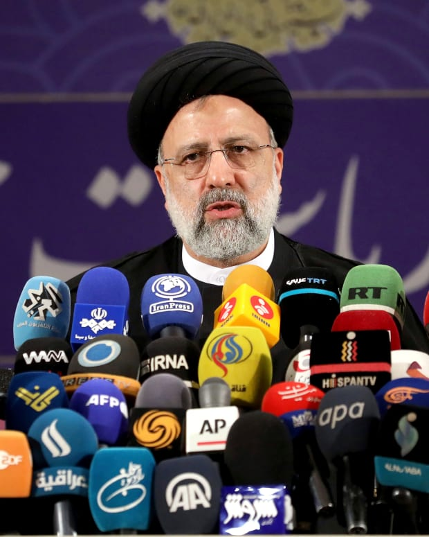 Ebrahim Raisi, head of Iran's judiciary speaks to media after registering his name as a candidate for the June 18 presidential elections at the elections headquarters of the Interior Ministry in Tehran, Iran, Saturday, May 15, 2021. (AP Photo/Ebrahim Noroozi)