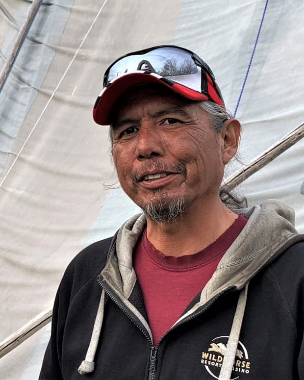 Toby Patrick, who hosted an Easter feast in April of 2020 that violated his tribes' COVID-19 restrictions and led to citations for 17 Native Americans, stands next to his family's canvas longhouse at his home on the Umatilla Indian Reservation. (Wil Phinney/Underscore)