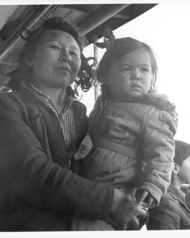 "Unangan, WWII, Funter Bay. Mother and daughter. Image titled ""nara_207247_m"": National Archives and Records Administration, NARA-207247-M (JE Note: Photo of Aleuts (Unangan) being transported from Pribilof and Aleutian islands to camps in SE Alaska during WWII. Presumably this is aboard the USAT Delarof)."