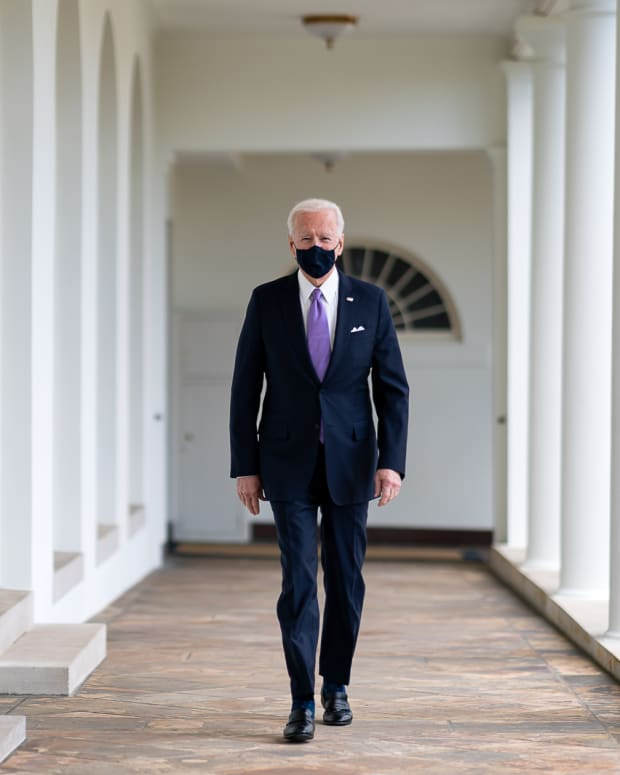 President Joe Biden walks along the Colonnade Thursday, Jan. 21, 2021, to the Oval Office of the White House. (Official White House Photo by Adam Schultz)
