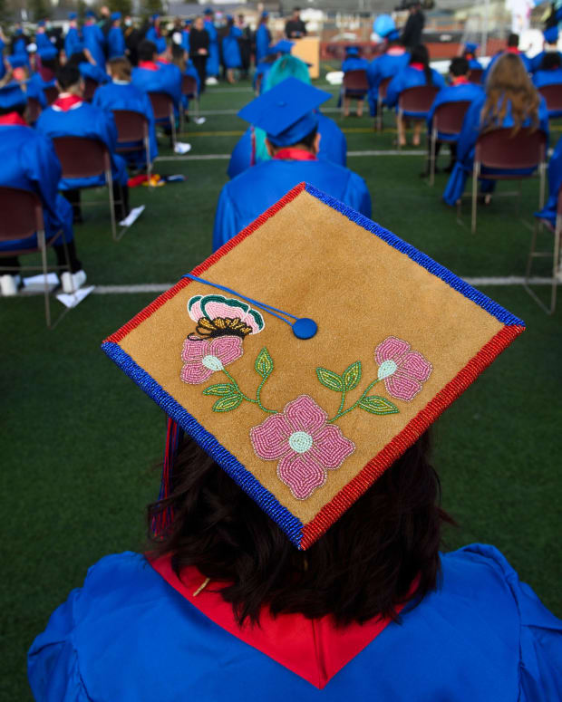 """Ermelina Gonzalez said her graduation cap was beaded by her mother. """"I'm really proud to be Athabaskan,"""" she said after her East High School graduation on May 11, 2021. (Marc Lester / Anchorage Daily News)"""