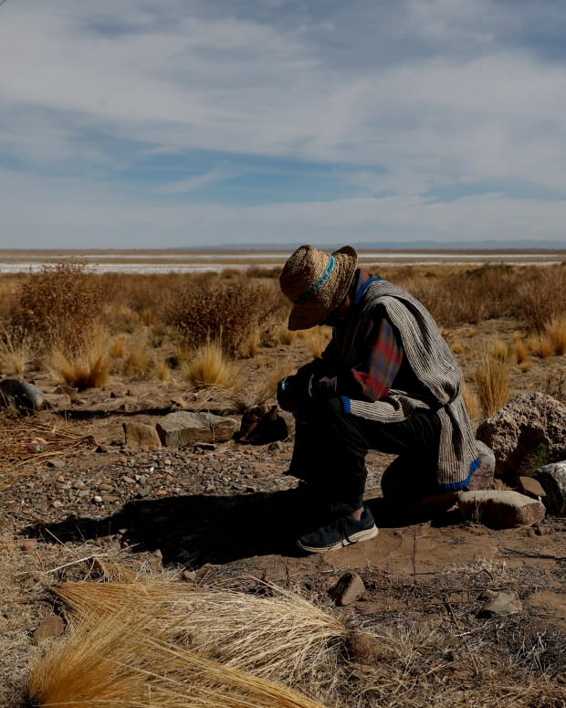 """Rufino Choque, the mayor of the Urus del Lago Poopo indigenous community, waits for the arrival of instructors, in Punaca, Bolivia, Monday, May 24, 2021. Lago Poopo, Bolivia's second-largest lake, gave life to a rich culture since the first men set foot on the Altiplano but it dried up about five years ago. """"We are ancient, but we have no territory. Now we have no source of work, nothing,"""" said Choque. (AP Photo/Juan Karita)"""