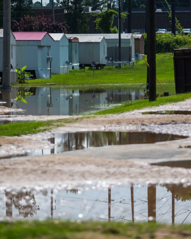 Standing water and destruction sit as a result of heavy flooding Saturday night at 2823 Hunter Creek Road, Sunday, June 20, 2021, in Northport, Ala. (AP Photo/Vasha Hunt)