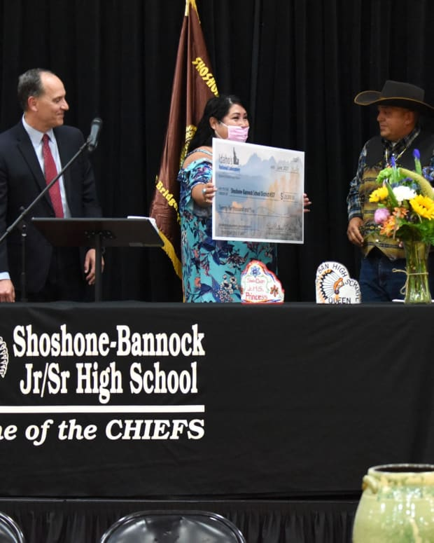 Pictured: Check presentation: Battelle Energy Alliance surprised the Shoshone-Bannock School District with a $25,000 donation during the MOU signing ceremony on June 22. From left to right: John Wagner, Becki Ingawanup, Tony Saiz, Sunshine Shepherd and David Archuleta.