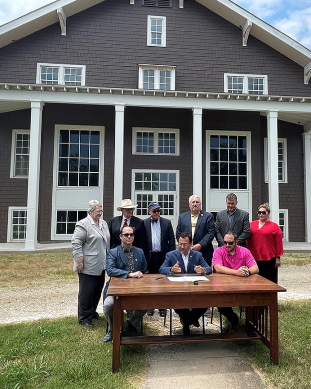 Pictured: Cherokee Nation officials joined representatives from Dwight Presbyterian Mission to formalize the acquisition of the historic Sequoyah County property. Officials are photographed in front of the 1917 schoolhouse, which was renovated in 2014 with vital support from Cherokee Nation. Front row: Preston Bobo, board vice president for Dwight Presbyterian Mission Inc., Cherokee Nation Principal Chief Chuck Hoskin Jr., Deputy Principal Chief Bryan Warner. Back row: Secretary of State Tina Glory Jordan, Bill Wiles, board treasurer for Dwight Presbyterian Mission Inc., Charlie Smith, administrative officer for Indian Nations Presbytery, District 5 Tribal Councilor E.O. Smith, Chief of Staff Todd Enlow, and Cherokee Nation Delegate to Congress Kimberly Teehee.