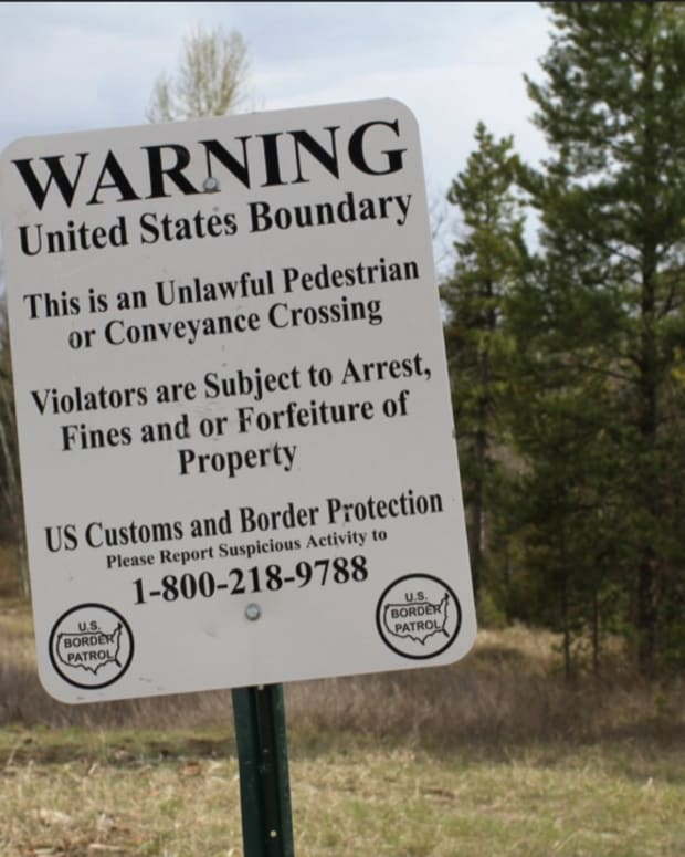 U.S. warning sign at Canadian border near the North Fork of the Flathead River, which drains from Canada to Montana, 2010 (Photo by Nicholas Brown, courtesy of Creative Commons)