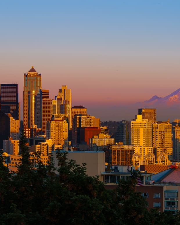 Mount Rainer looms in the background of the Seattle skyline at sunset. (Photo by Howard Ignatius via Creative Commons)