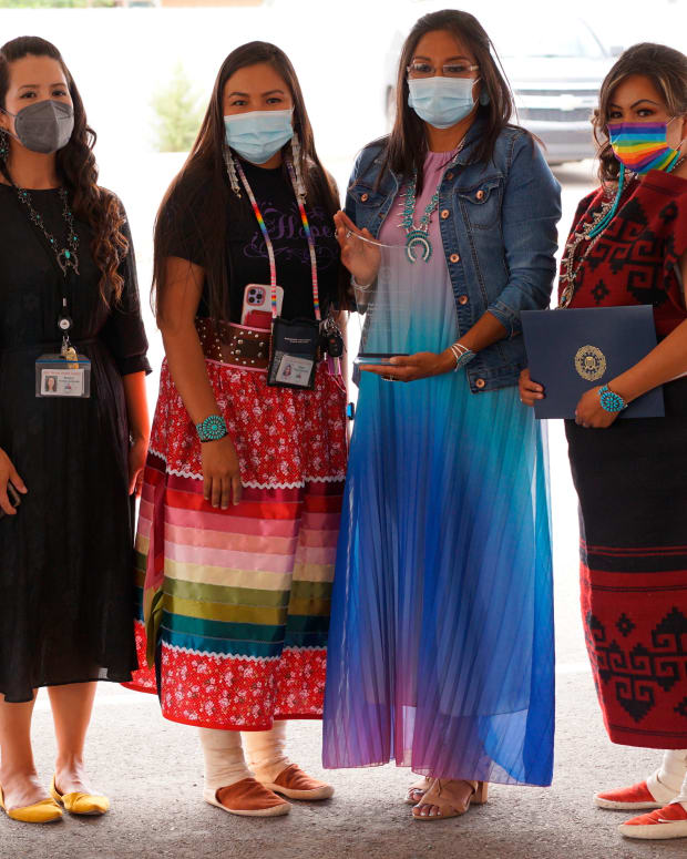 An agent with the FBI poses with Utah Navajo Health System's victim advocates Jessica Holiday, second from left, Tonya Grass, Lynn Bia and Danialle Whitehat, who received a community leadership award from the FBI in Montezuma Creek, Utah on Wednesday, July 14, 2021. Agents from the FBI office in Salt Lake City traveled to southern San Juan County to award Utah Navajo Health System (UNHS) for its victim advocacy program, which Navajo Nation Council Delegate Amber Kanazbah Crotty and others hope will become a model program for supporting victims of sexual assault and domestic violence across the Navajo Nation.(Zak Podmore /The Salt Lake Tribune via AP)