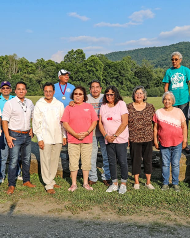 Pictured: Cherokee Nation Principal Chief Chuck Hoskin Jr. and Deputy Chief Bryan Warner joined Eastern Band of Cherokee Indians Principal Chief Richard Sneed and fluent Cherokee speakers from both tribes at the historic Kituwah Mound near Cherokee, North Carolina, recently to sign an agreement to protect and preserve the Cherokee language, history and culture.