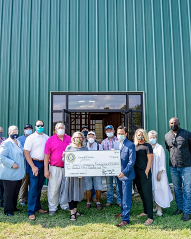 Pictured: Cherokee Nation officials recently met with leaders from Vian Community Foundation in Sequoyah County to present a $250,000 check as part of the tribe's $30 million Housing, Jobs and Sustainable Communities Act of 2019, which earmarks a portion of funds to upgrade Cherokee community buildings with connectivity and sustainability projects.