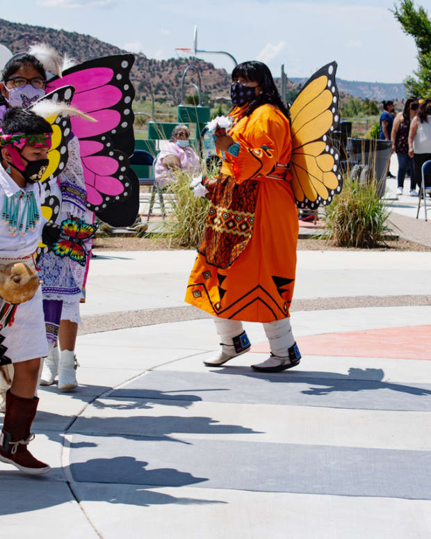 Pictured: During Zuni Enrichment Project's Summer Camp closing celebration on July 16, 65 campers ages 7-12 performed corn, hunter, and butterfly dances they had practiced throughout the four-week camp, wearing regalia they made themselves.