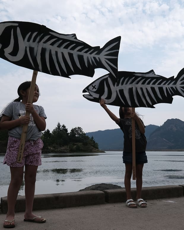 Pictured: Yakama Nation leaders and over 40 people gathered along the Columbia's scenic Little White Salmon River for a Salmon Vigil, an an event to raise awareness about the ongoing death of sockeye salmon impacted by hot water.