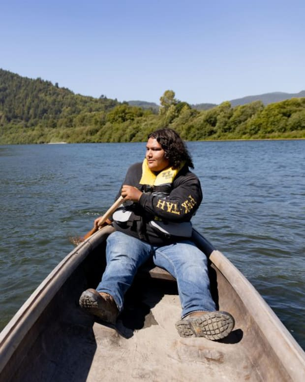 Chinook salmon, the Klamath River's main resource, have been harmed by climate change and a dam upstream, according to Sammy Gensaw, director of Ancestral Guard, which teaches Indigenous youth how to farm as well as fish. (Photo by Beth Wallis/News21)
