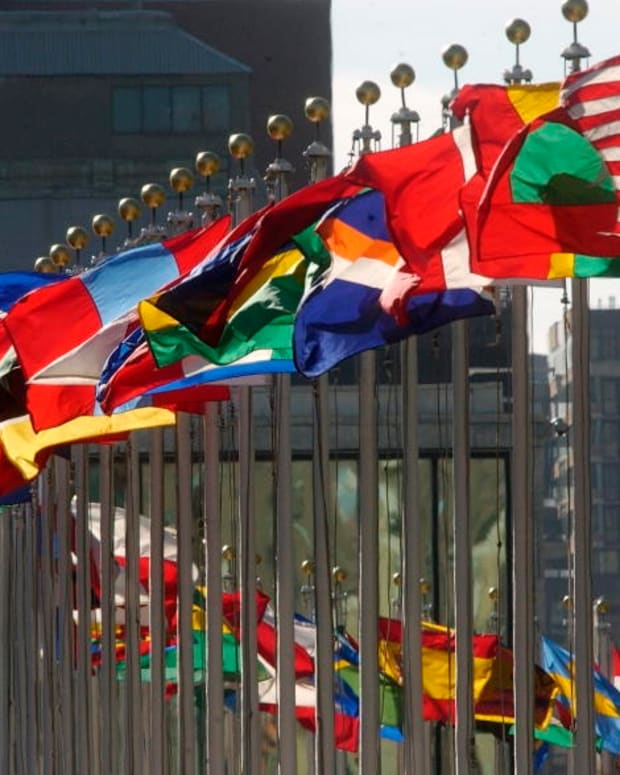 Flags of member nations fly high in this 2005 photo at the United Nations, which is hosting a worldwide climate change conference Nov. 1-12, 2021, in Glasgow, Scotland. Indigenous leaders, however, are facing barriers gaining access to the conference. ( UN Photo by Joao Araujo Pinto via Creative Commons)