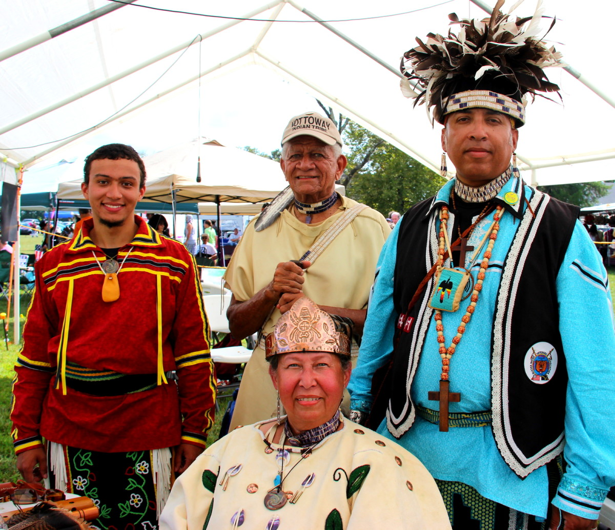 Chief Lynette Allston (center, seated) is proud of the male warriors in her tribe - Photo: Vincent Schilling