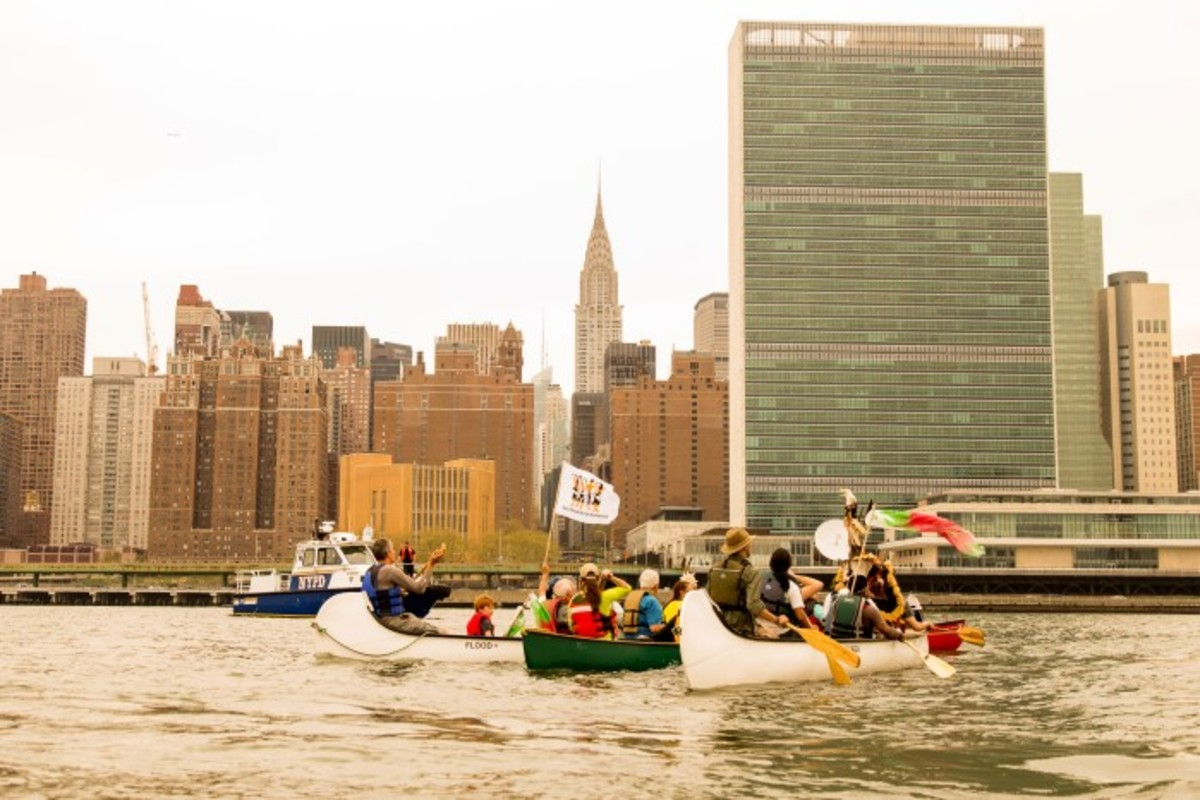 The NYPD stops members of Global Canoe on the East River before they can reach the U.N. to deliver their Indigenous Rights Declaration. Photo-Alex Hamer