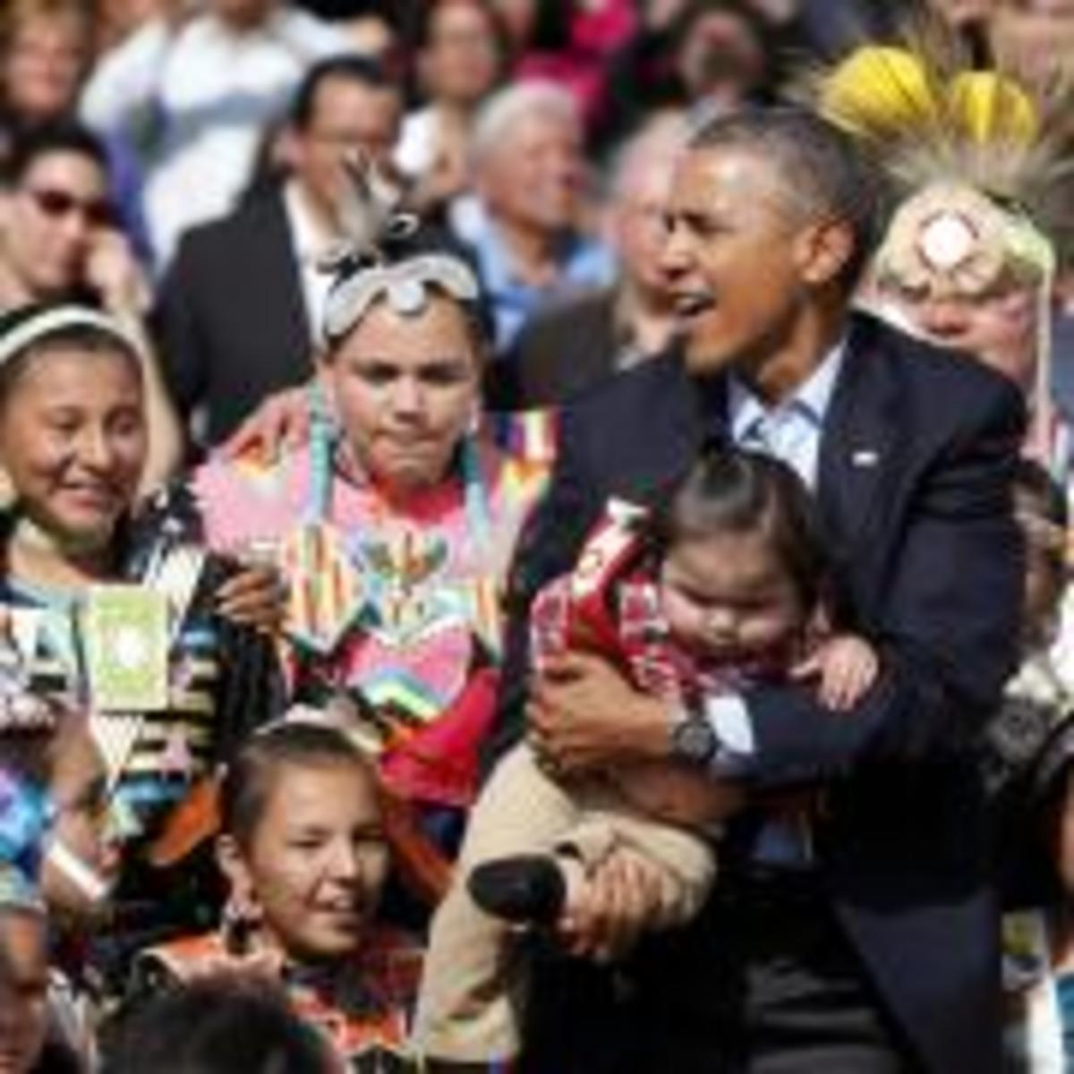 President Barack Obama poses with Native America dancers during his visit to the Standing Rock Indian Reservation Friday, June 13, 2014, photo in Cannon Ball, North Dakota. It was this visit to Standing Rock that got the ball rolling for today's youth gathering in D.C.