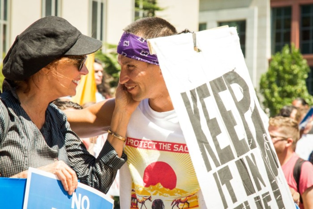 Susan Sarandon greets a water protector on the steps of a Washington, D.C. courthouse in August. Photo-Alex Hamer