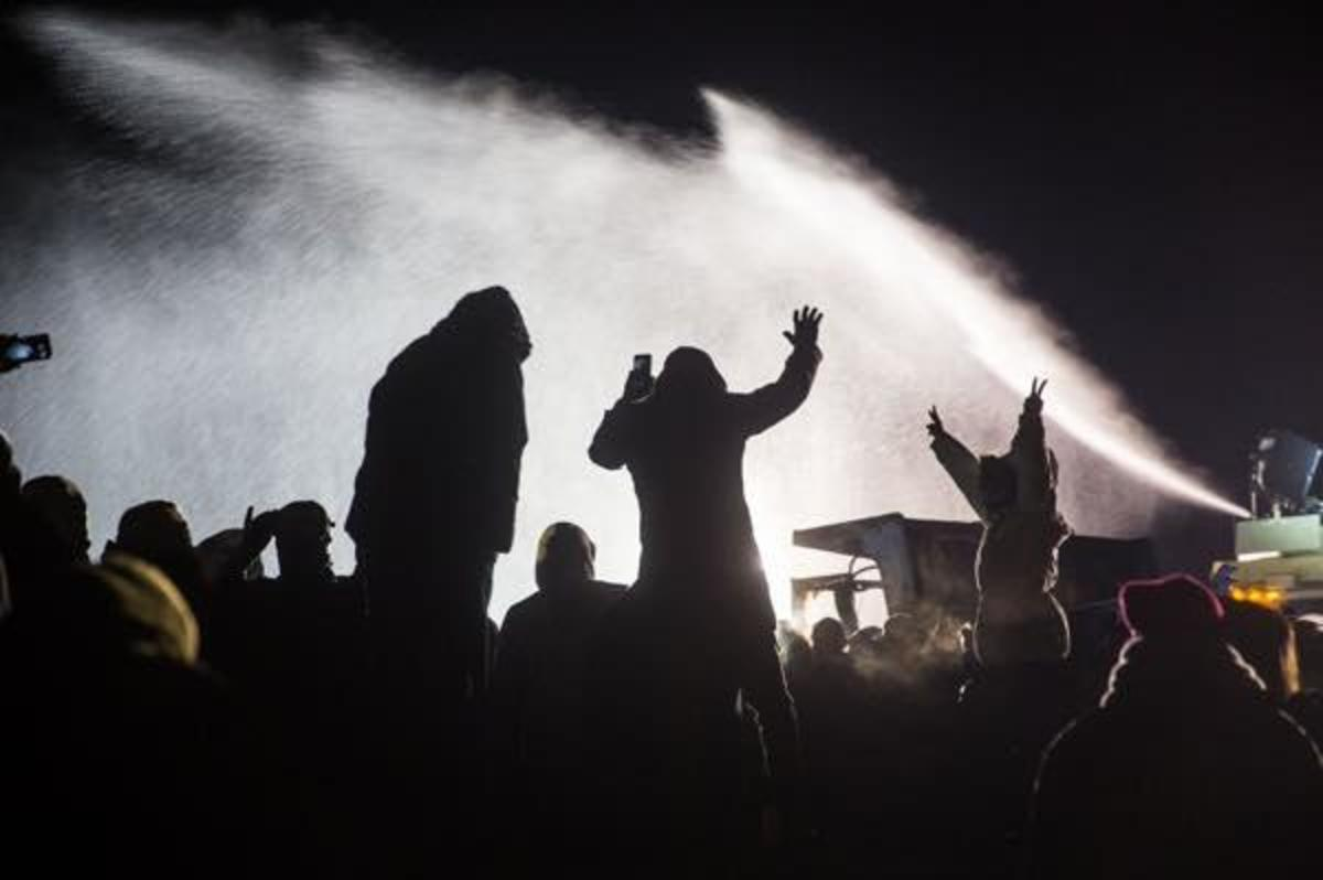 Hoses or water cannons were used to spray protectors in subfreezing temperatures overnight on Sunday November 20 at Standing Rock.