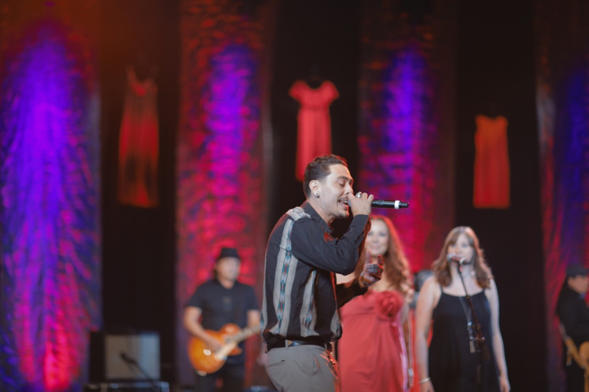On a stage adorned with red dresses in honor of Missing and Murdered Indigenous Women, PJ Vegas performed 'Come and Get Your Love' and accepted a Lifetime Achievement Award on behalf of his father Pat Vegas, from the iconic group, Redbone.