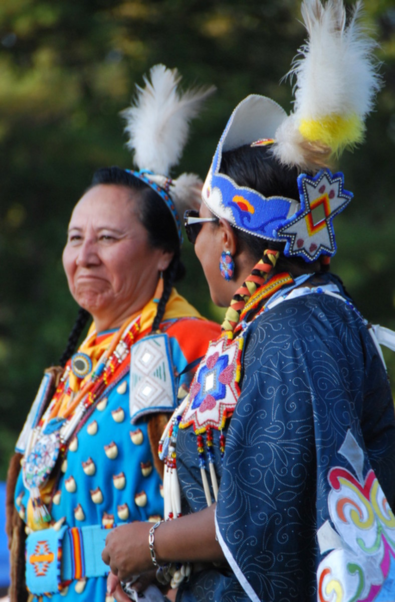 Two strong Native women share words in the pow wow circle. Photo Vincent Schilling International Women's Day.