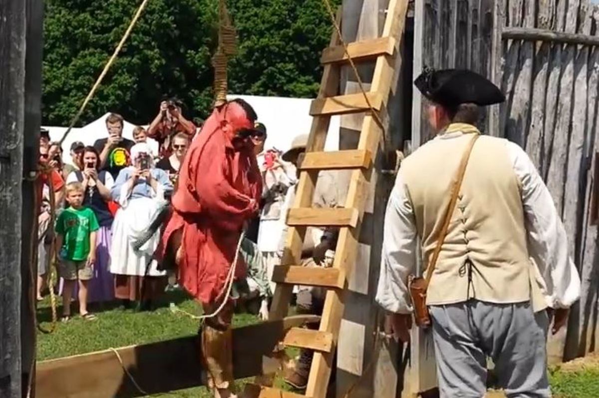 An alleged Lenape actor hangs from a rope in the full view of children and onlookers as part of the Westmoreland County Historical Society reenactment of the public hanging of Mamachtaga, a Native American Delaware man convicted of murder in 1785. YouTube screen capture
