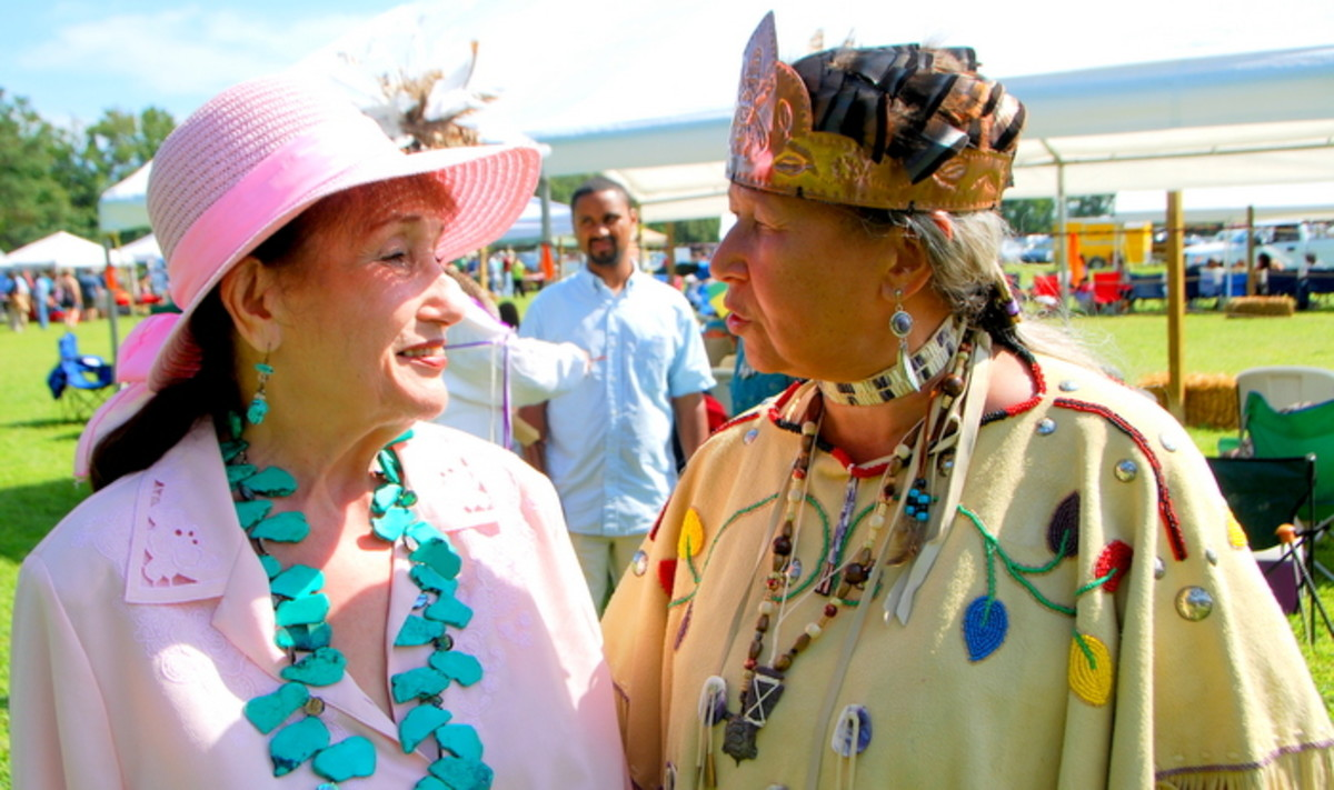Two amazing Native women, Lynette Allston and Paige Archer, share a moment. Paige passed away a few years ago. Photo Vincent Schilling International Women's Day.