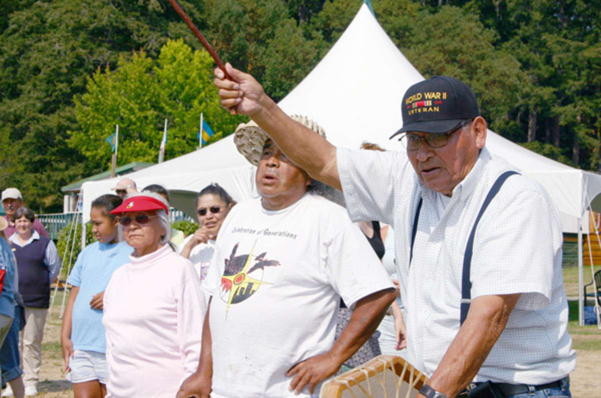 "Right, Swinomish Senator Chester Cayou welcomes canoe pullers to Roche Harbor on San Juan Island, during an early 2000s Canoe Journey. ""This is how it was,"" he told pullers. ""This is how your ancestors lived -- they loved each other, cared for each other, and shared with each other."" Cayou walked on in 2010."