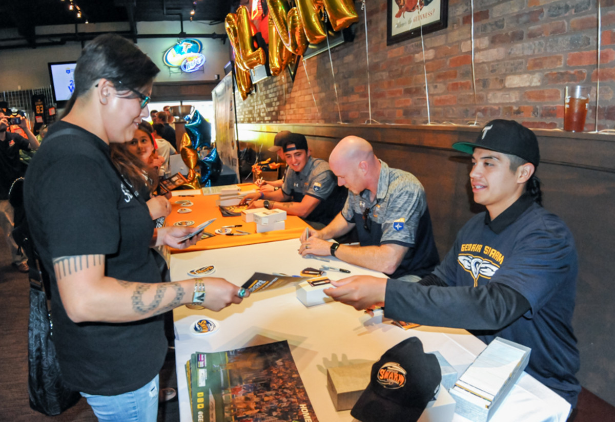 Miles Thompson visits with excited fans who lined up for Swarm autographs at the welcome home Championship celebration on June 15th, 2017. - Amy Morris