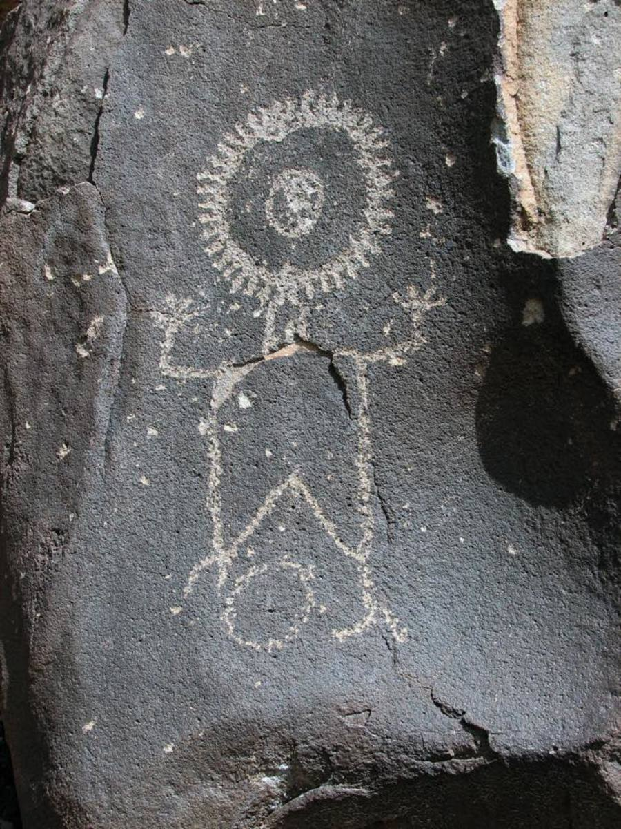 The Wells Petroglyph Preserve on Mesa Prieta has scores of petroglyphs, like this one that the School for Advanced Research describes as a sun person.