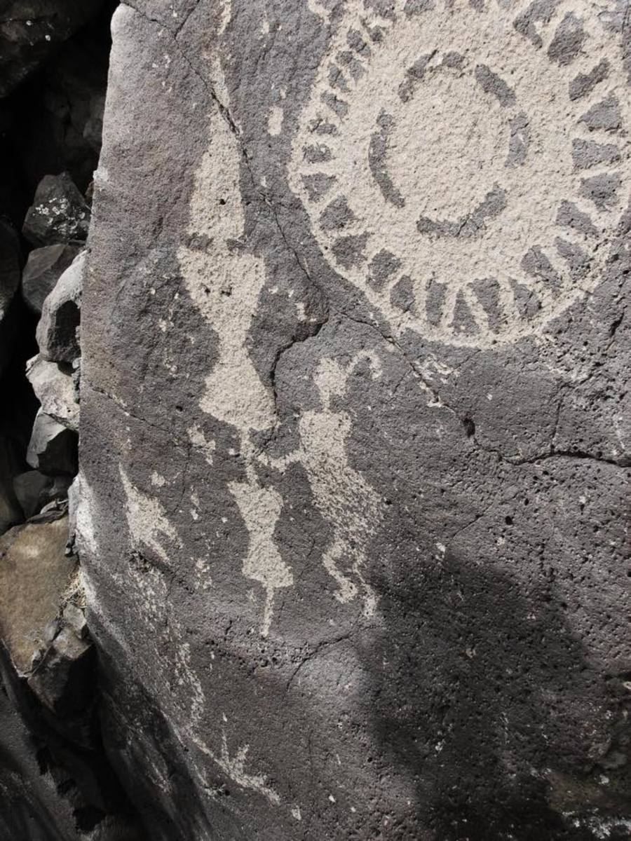 The Wells Petroglyph Preserve on Mesa Prieta has scores of petroglyphs, like this one that the School for Advanced Research describes as a person with a large arrow with hourglass shaped attachments.