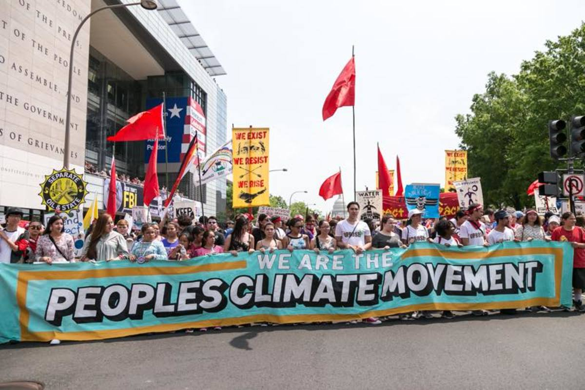 Native youth carried one of the banners that lead the head of the People's Climate March.