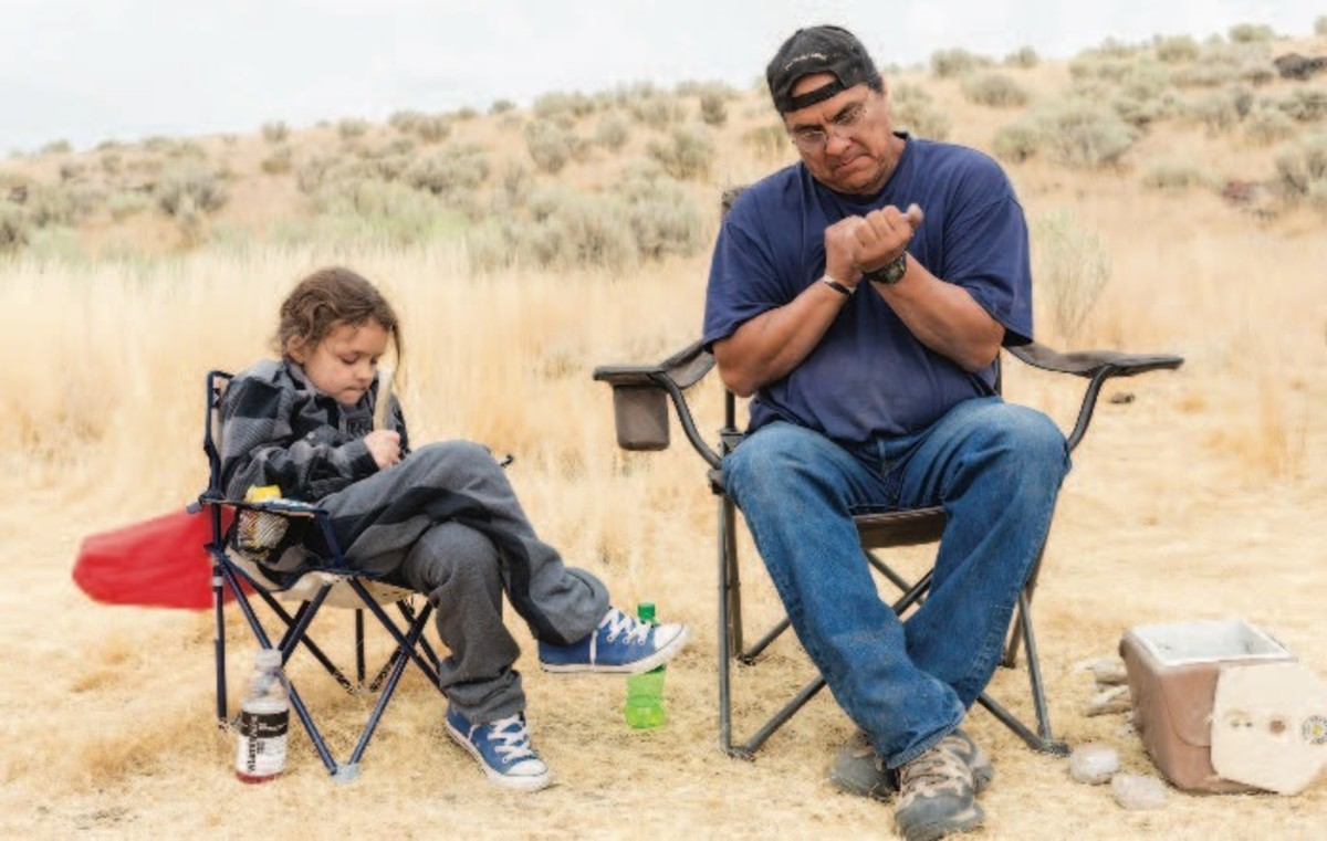 ICMN MAGAZINE_1_April_May_2017_Page_045_A Point In Time_Flintknapping__Holley and his grandson Julius Jr. collect rocks for a sweat-lodge ceremony_flintknapping lesson_image 001
