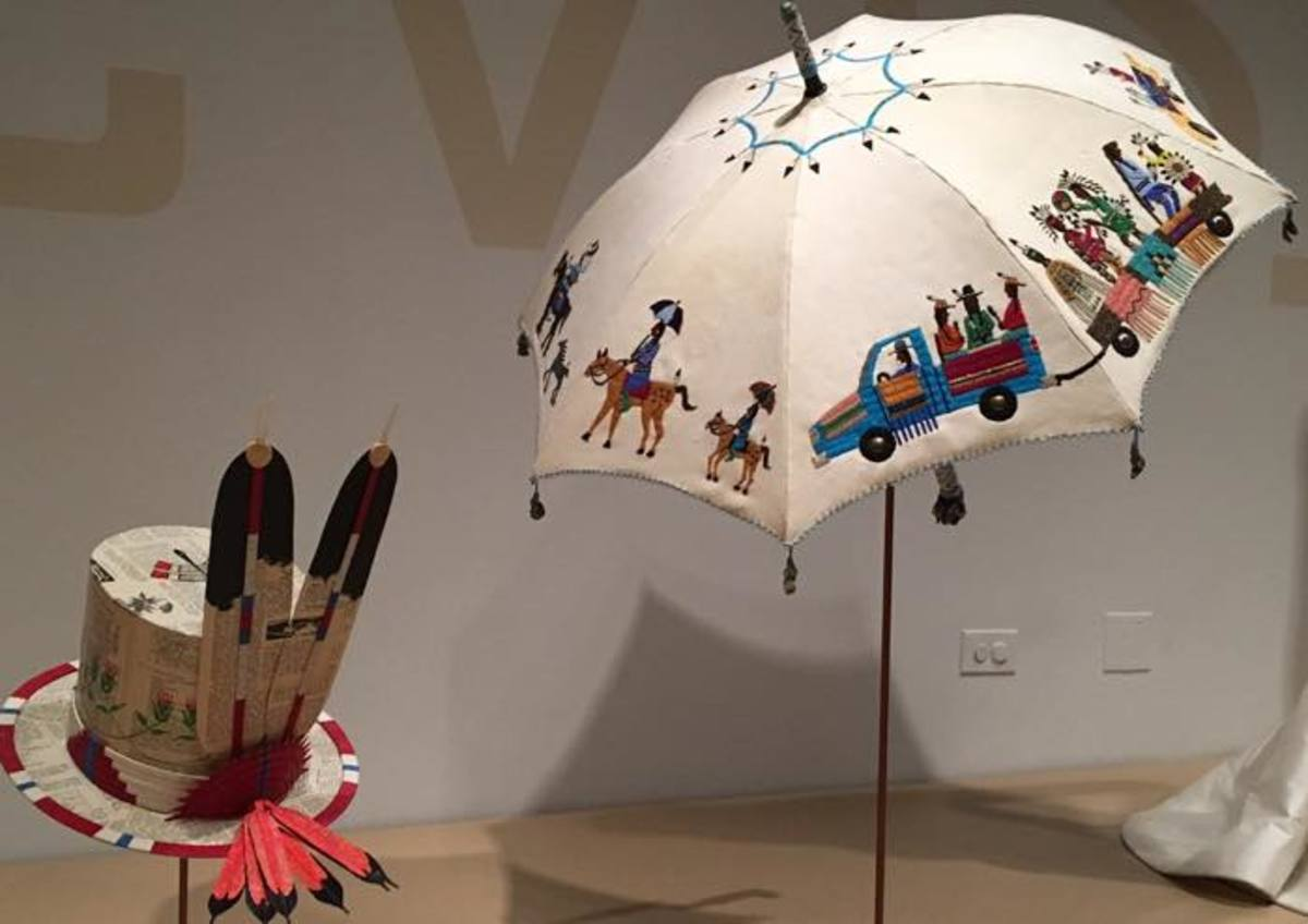 In the second half of the 19th century, Plains Indians began adopting European fashions like top hats and parasols, adding personal embellishments like porcupine quills and beads. Dwayne Wilcox (Oglala Lakota) created this hat from vintage paper with a dragonfly on top that symbolizes protection. Teri Greeves (Kiowa) created this parade umbrella from deer hide and was inspired by those carried during the annual Crow Fair in Montana.