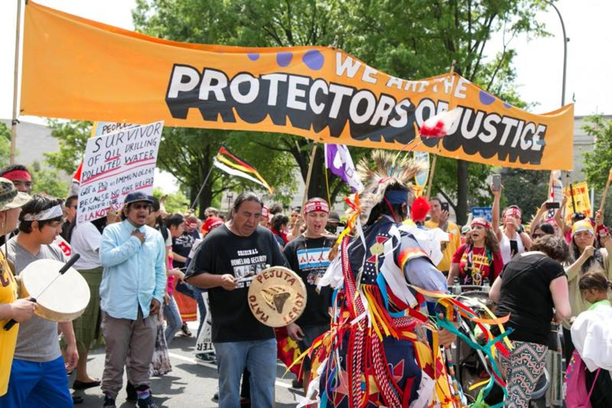Traditional song and dance carried this group through the People's Climate March in Washington DC.