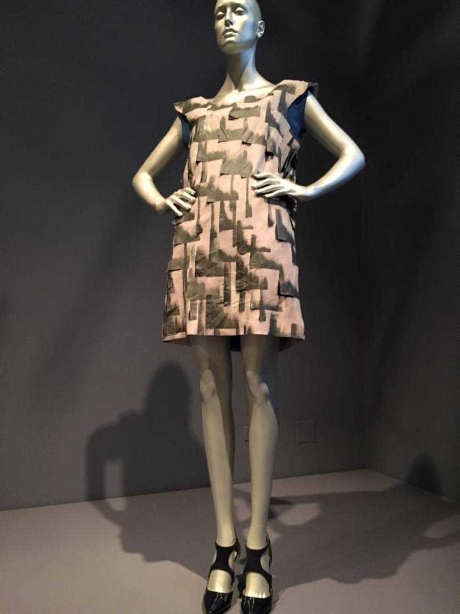 Taos Pueblo designer Patricia Michaels integrates the handmade and the machine-made. Like in her Cityscape dress, which evokes Manhattan buildings reflected in water, but from a distance seem to be pure pattern.