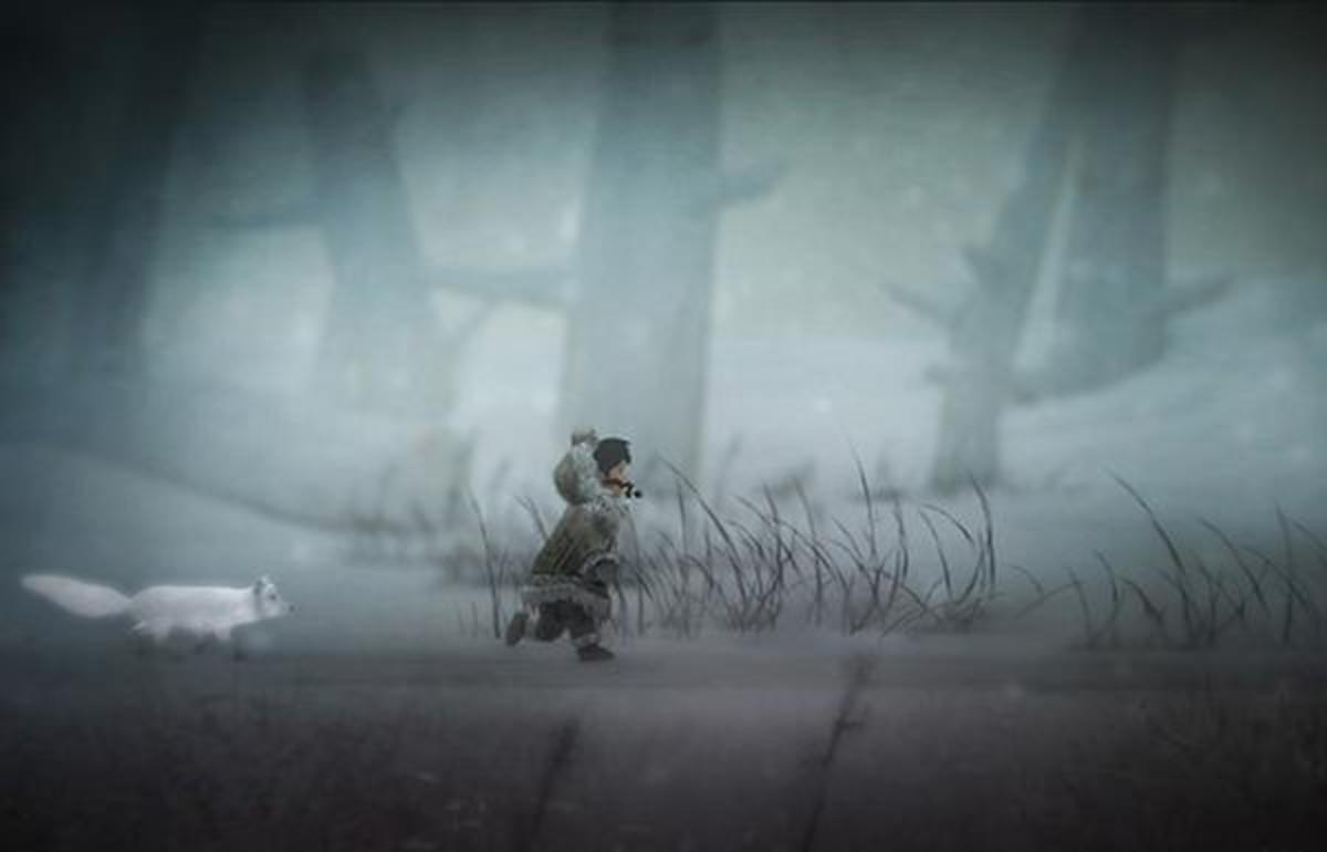 Nuna, trailed by her Arctic fox friend, in a screenshot from 'Never Alone.'