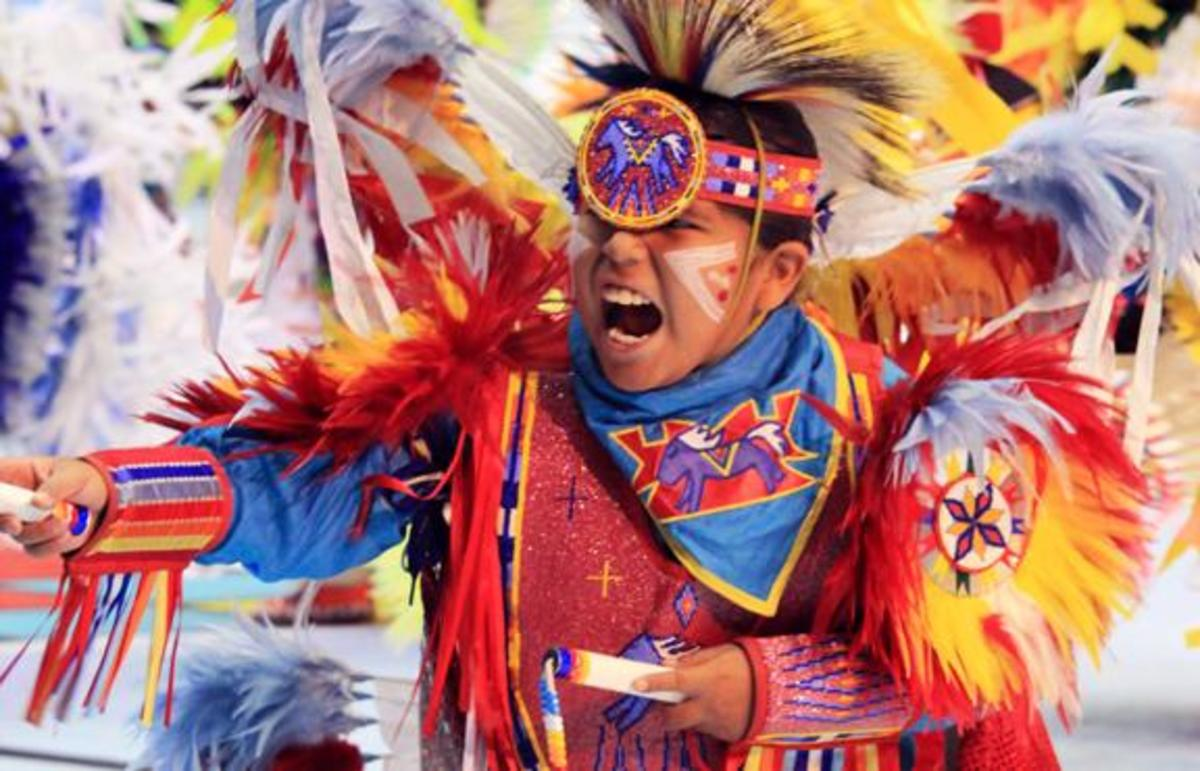 We thought our readers would appreciate some great images of our young Native warriors in regalia that will be carrying on for the upcoming generation. Junior boy fancy dancer nails the end of his song right on cue.