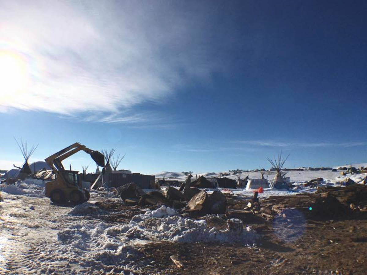 Bulldozers have arrived at the main Oceti Sakowin camp to begin the clean-up process before the potential of spring flooding. The camp, nestled along the confluence of the Cannon Ball and Missouri Rivers has been the center of the months-long movement against the Dakota Access pipeline that swelled, by some accounts, to as many as 14,000 people in early December.